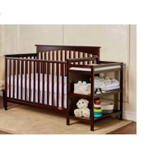 Baby S Brown Wooden Crib With Diaper Changing Station And