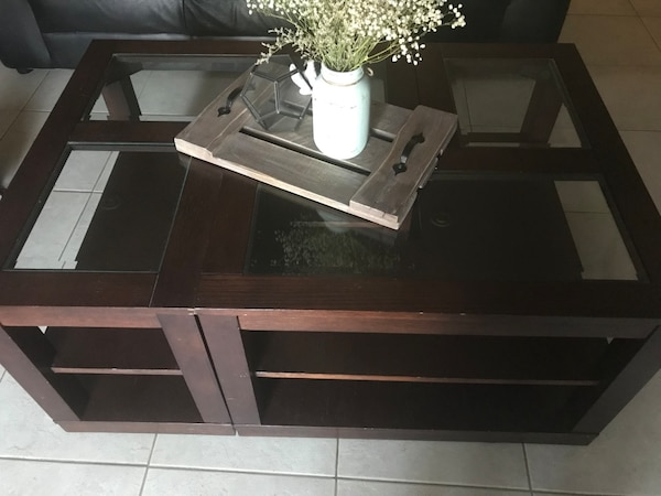 rectangular brown wooden framed glass top coffee table