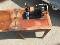 Working antique sewing machine. Only need electric cord.    You will need to sand the top of the wood since it is a antique. Elmhurst, 60126