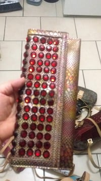 red gemstone encrusted gray crocodile leather long wallet Toronto