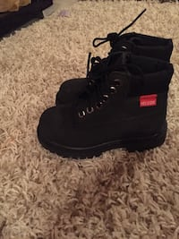 Pair of black timberland helcor leather boots Hamilton, L0R 1C0