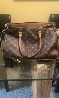 Louis Vuitton  Calgary, T2H 0L8