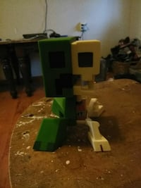green and white Minecraft character figurine