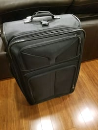 Suitcase large with wheels (American tourister)