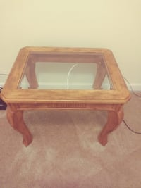 rectangular brown wooden framed glass top coffee table Jacksonville, 32207