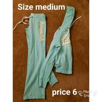 teal and white Adidas track pants Martinsburg, 25404
