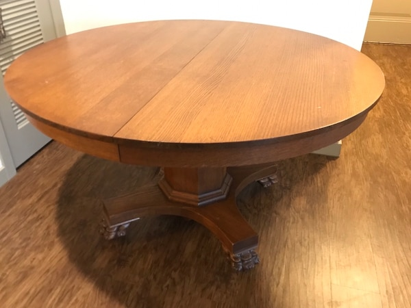 Antique, oak table with 2 leaves and 4 original matching chairs.