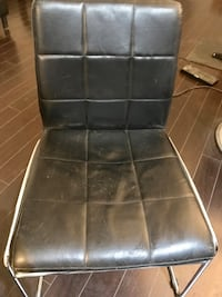 Black tufted leather chairs