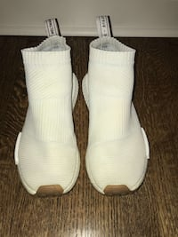 Pair of white adidas shoes