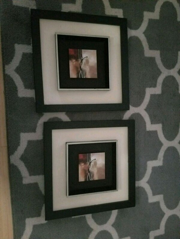 two black wooden photo frames