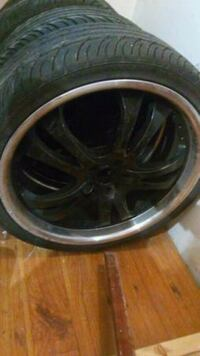 black 5-spoke car wheel with tire Surrey