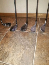 three black and gray golf clubs Division No. 11, T8E