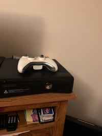 black Xbox 360 with controller 50 km