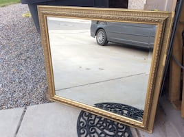 High-quality mirror with beveled edge in gold-colored frame
