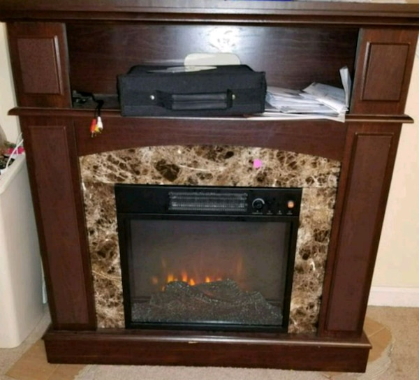 Electric fire place with marble frame