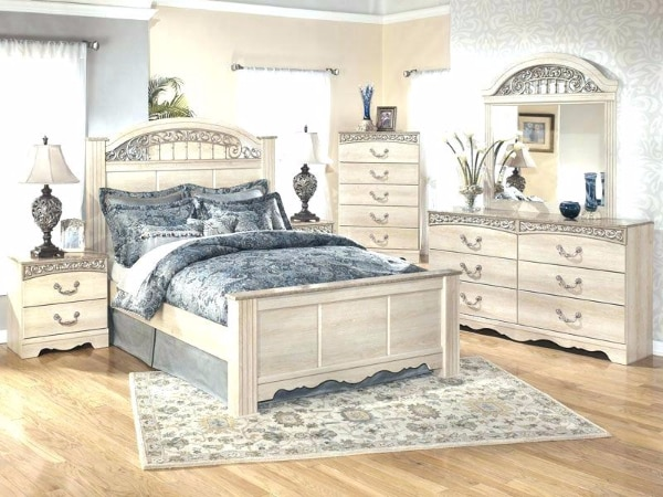white wooden bed frame with white bed comforter set