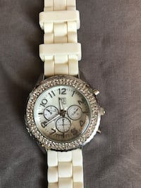 round silver Michael Kors chronograph watch with white link bracelet