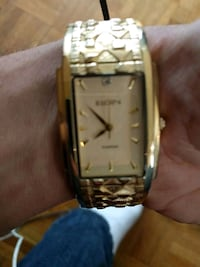 square gold-colored analog watch with link bracele Calgary, T3C 0T4