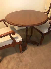 """3 pieces wood dining set table30"""" tall 33"""" round with 2 armchairs smoke pet kids free home pick up in Gaithersburg md 20877 Gaithersburg"""