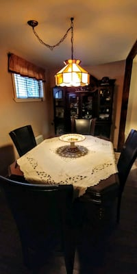 round brown wooden table with four chairs dining set Terrebonne, J6X 4C1