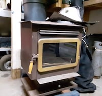 Woodstove - Warnock Hersey. Has stainless steel exhaust pipes for a 3 story house