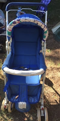 Baby's blue green and white printed stroller