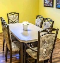rectangular brown wooden table with six chairs dining set Oakville, L6J