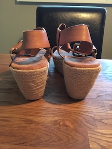 women's pair of brown open-toe wedge shoes