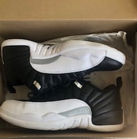 Pair of black-and-white air jordan 12 Germantown, 20874