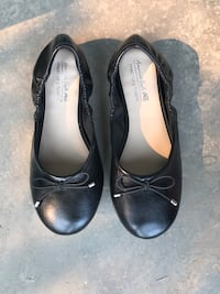 pair of black leather flats Calgary, T2Y 3R4