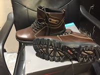 pair of brown leather work boots with box Calgary, T3C 0N6