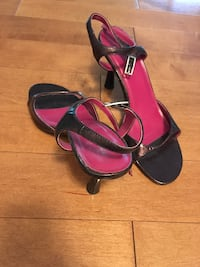 pair of black-and-red leather sandals HERNDON