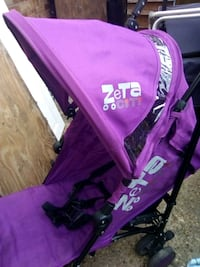 pink and black Baby Trend stroller Romford, RM3 8YP