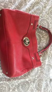 Red leather coach. Brand new Toronto