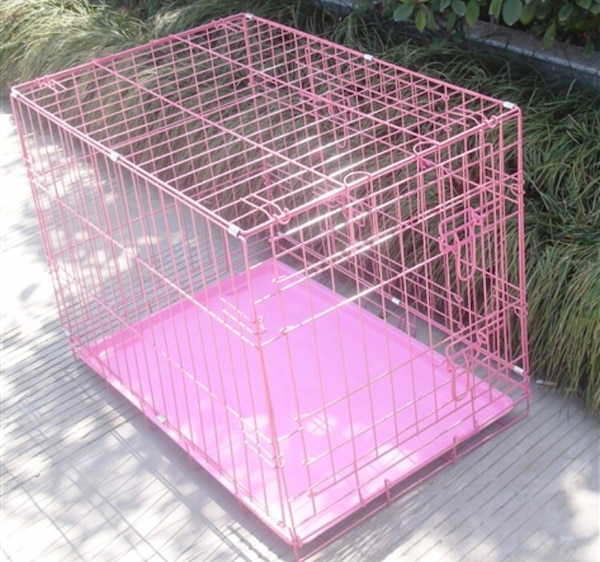 pink and white metal pet cage