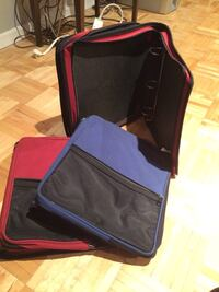 Black and red  binders with zippers Laval, H7X 3P4