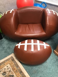 Football chair with ottoman alittle hole on corner but it's fixable
