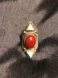 red cabochon stone encrusted accessory