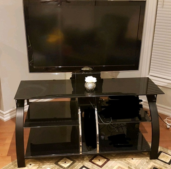 Used Tv Stand With Black Tampered Glass Shelves For Sale In Brampton