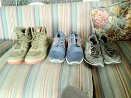 One pair of boots and two pairs of shoes