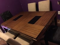 brown wooden table with chairs Houston, 77033
