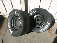two black bullet hole car wheels with tires Los Angeles, 91335