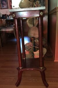 Utility table with marble top cherry finish, 31 inches tall