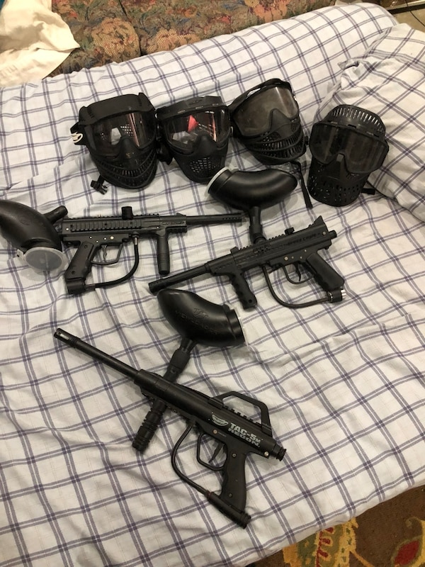 3 paint balls guns and 4 mask