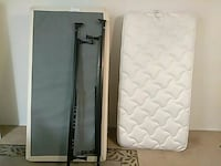 black metal standard bed frame and white mattress Tallahassee, 32309