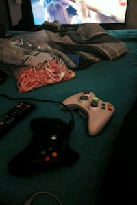 two black and white Xbox 360 controllers St. Albert, T8N 2W8