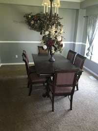rectangular brown wooden table with four chairs dining set West Jordan, 84081
