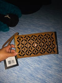 brown and black leather crossbody bag 38 km