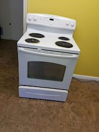 white and black 4-coil electric range
