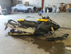 black and yellow snowmobile